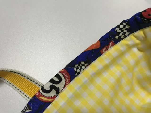 袋の口を縫う